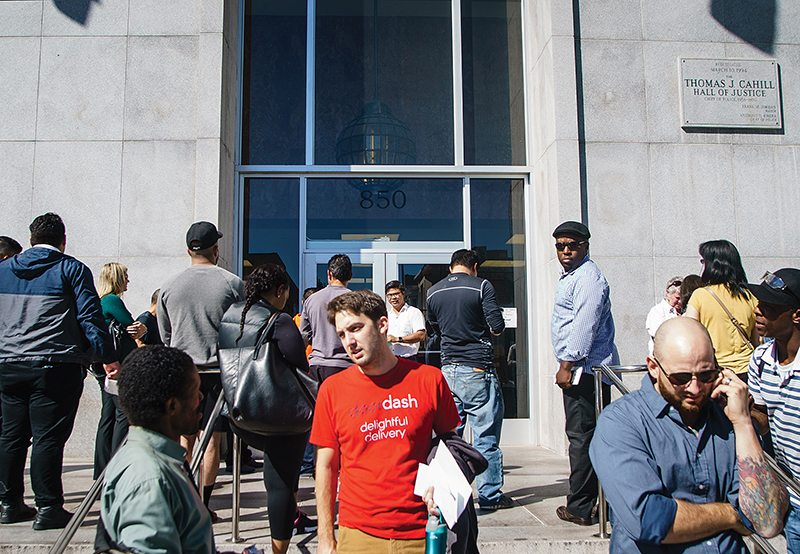People stand outside of an evacuated Hall of Justice after a bomb threat on 7th and Bryant Streets in San Francisco's SoMa neighborhood Thursday, October 20th, 2016. (Dan Chambers/Special to S.F. Examiner)