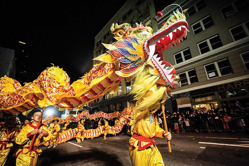 Participants perform a dragon dance on Kearny Street during at the annual Chinese New Year parade, Saturday, February 20, 2016. (Ekevara Kitpowsong/ Special to S.F. Examiner)