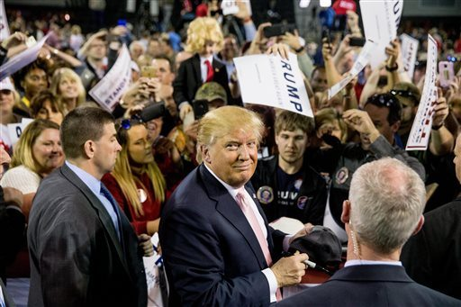 Republican presidential candidate Donald Trump greets members of the audience after speaking at a rally at Valdosta State University in Valdosta, Ga., on Monday. (AP Photo/Andrew Harnik)