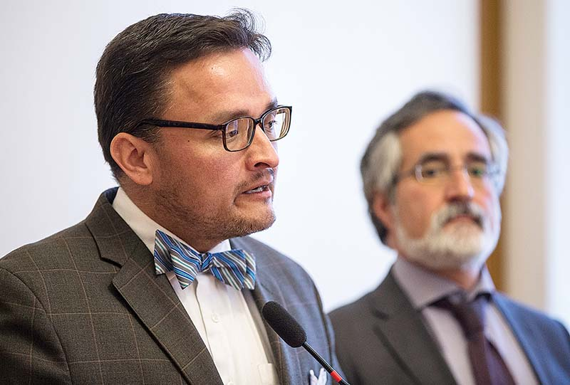 Supervisors David Campos, left, and Aaron Peskin announce new legislation that would further regulate short-term rentals in San Francisco during a news conference on Monday at City Hall. (Jessica Christian/S.F. Examiner)