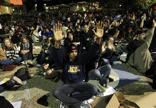 Demonstrators raise their hands as they vote on petitions at Sproul Plaza on the campus of the University of California at Berkeley