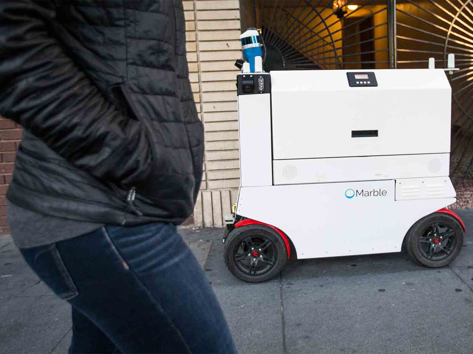 A Marble delivery robot rolls down Valencia Street in San Francisco's Mission District. (Jessica Christian/S.F. Examiner)