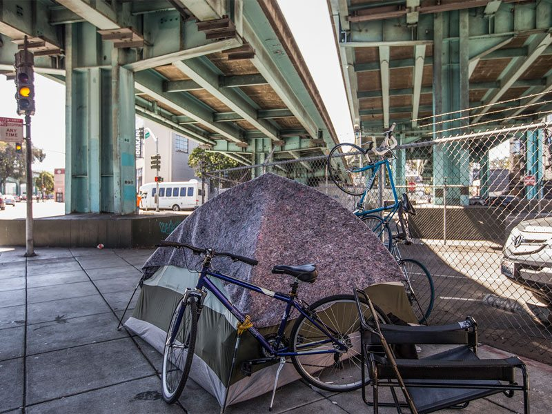 A tent is seen set up near Division and Brannan streets in San Francisco on June 24. (Jessica Christian/S.F. Examiner)
