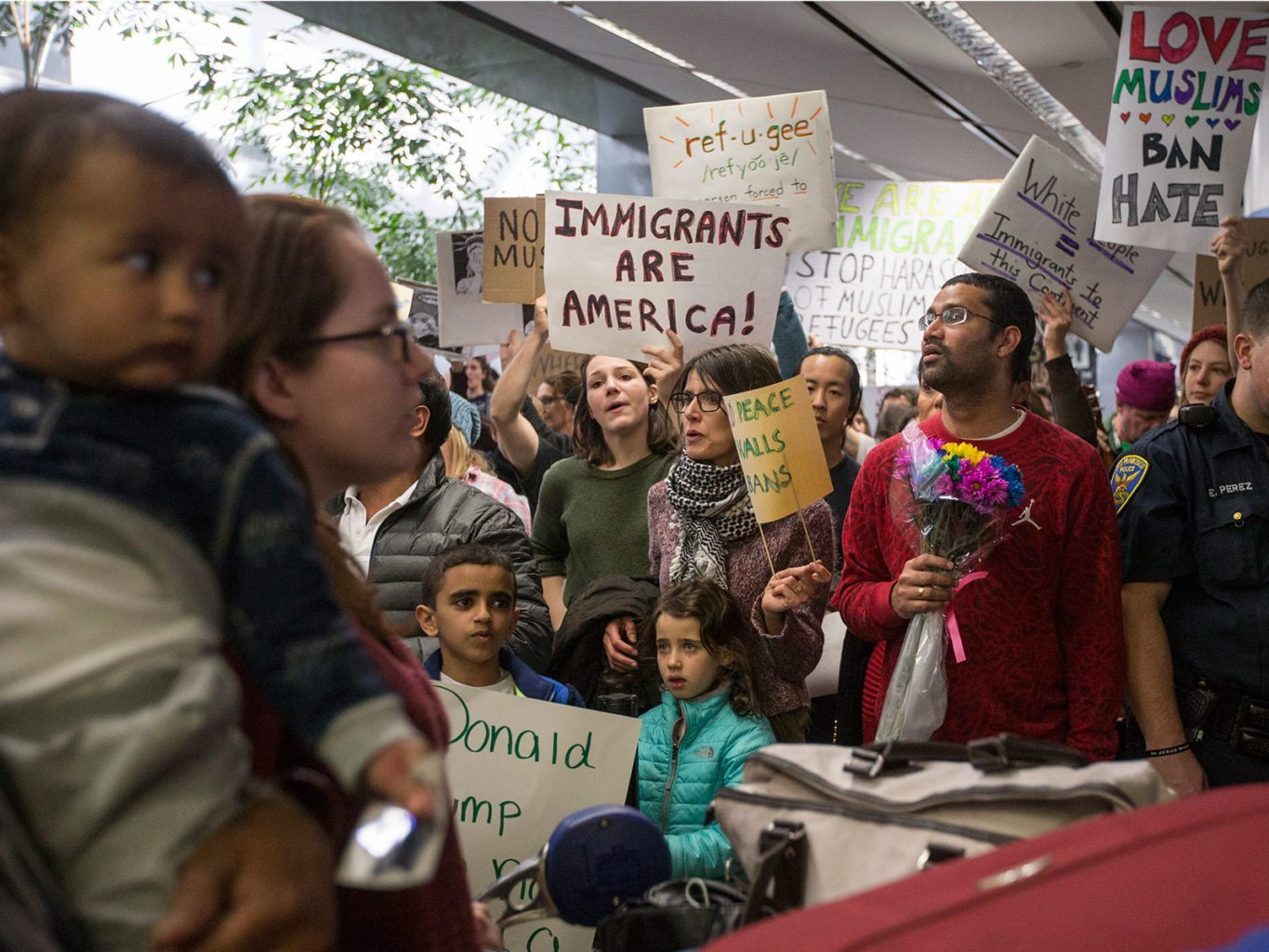 People gather near the exit of customs screening during a protest at San Franicsco International Airport on Jan. 29. (Jessica Christian/S.F. Examiner)