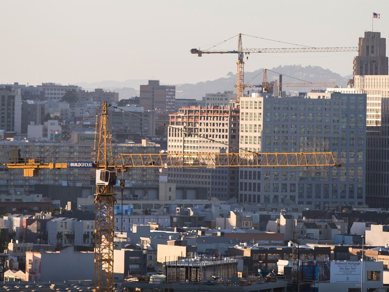 Construction cranes are seen over downtown San Francisco on March 31, 2016. (Jessica Christian/S.F. Examiner)