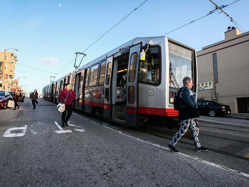 Passengers exit from a Muni L Taraval train on Taraval Street between 28th and 29th avenues in the Parkside neighborhood. (Ekevara Kitpowsong/ Special to S.F. Examiner)