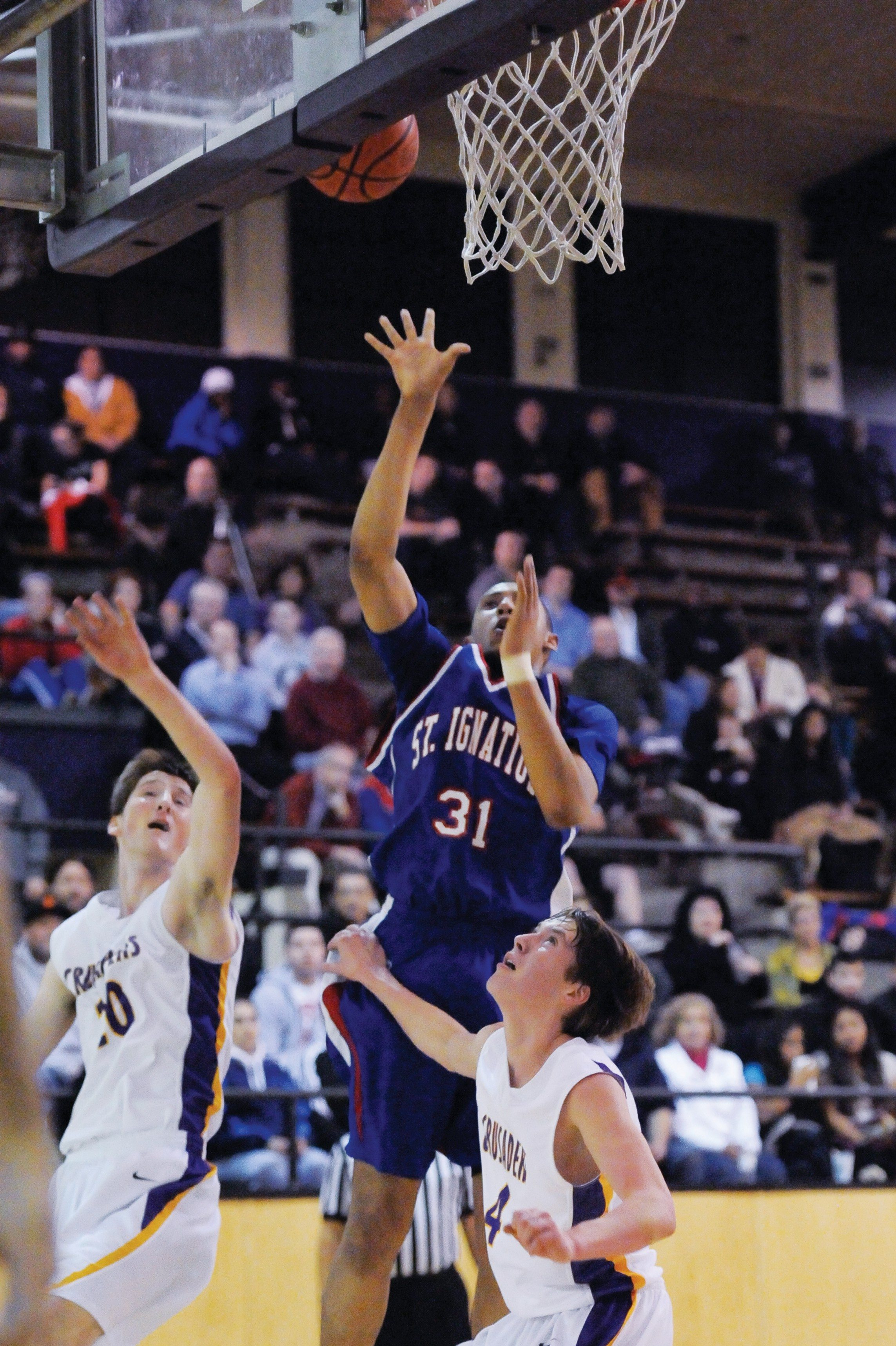 Doug Ko/Special to The ExaminerSt. Ignatius' Stephen Domingo (31) took advantage of his 6-foot-7 frame on Tuesday to score 18 points and pull down 11 rebounds in the Irish's WCAL victory against Riordan.