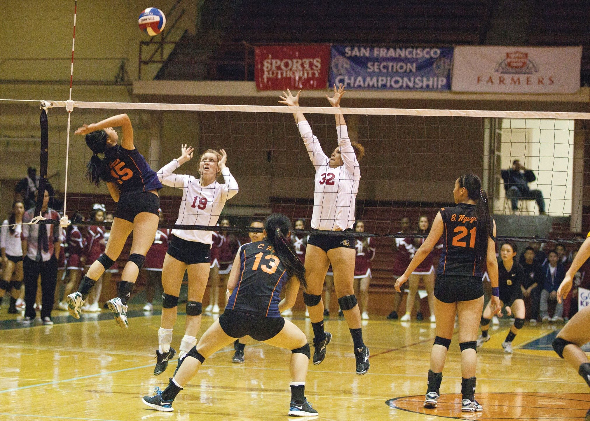 Joseph Schell/Special to The ExaminerSenior Elaine Guan goes up for a spike during Balboa's AAA championship victory against Lowell on Thursday at Kezar Pavilion.