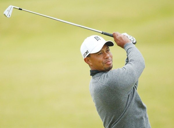 getty images file photoStill clawing: Tiger Woods could return to the top of the world rankings by pulling off a win this weekend at Lytham