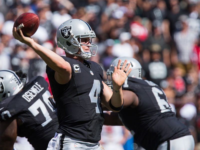 Derek Carr may have been drafted behind Jacksonville play-caller Blake Bortles, but the Raiders quarterback proved Sunday that he's got the higher ceiling. (Stan Olszewski/Special to S.F. Examiner)