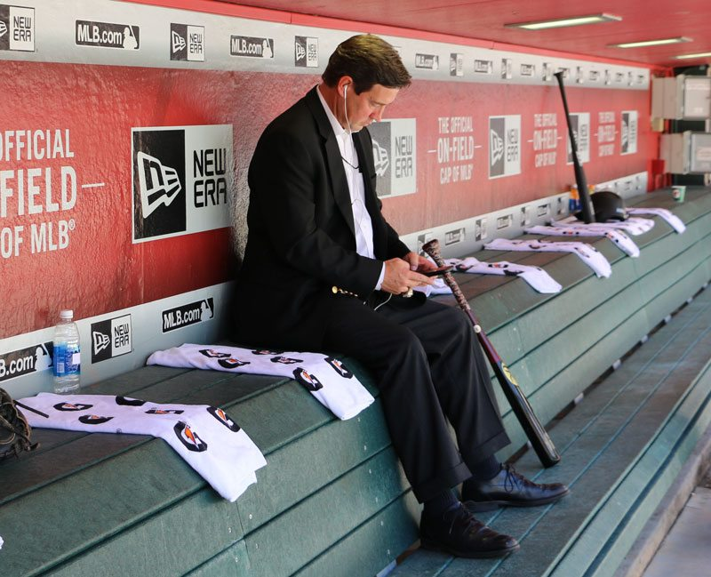 Former San Francisco Giants general manager Bobby Evans sits in the home dugout in 2017. (Jacob C. Palmer/S.F. Examiner)