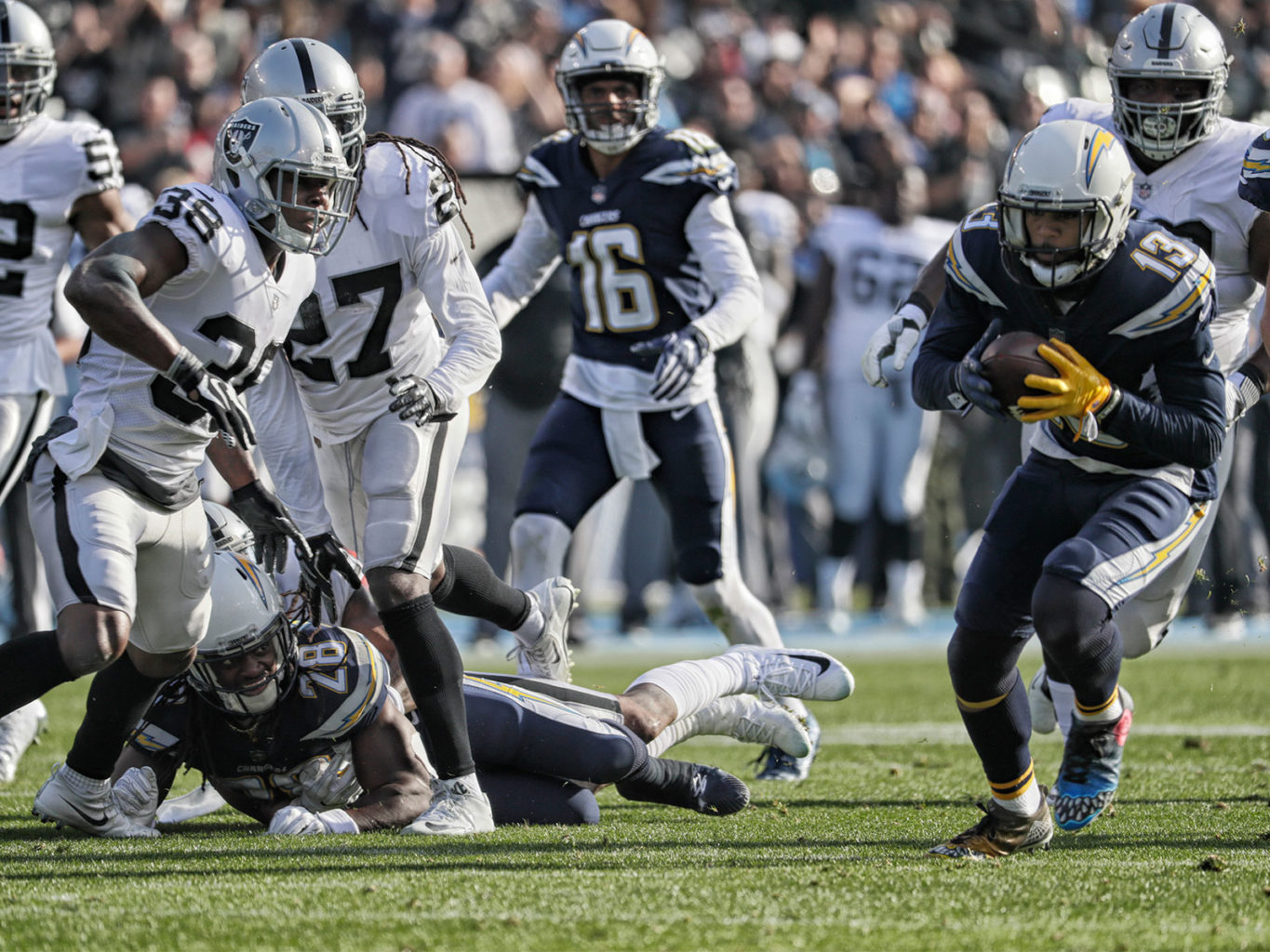 The Chargers' Keenan Allen runs for a touchdown after recovering a fumble in the first quarter of Los Angeles' 30-10 win over the Oakland Raiders on Sunday. Just like Sunday's contest, most of the Raiders were no-shows on Monday when the team was scheduled to be available to the media. (Robert Gauthier/Los Angeles Times/TNS)