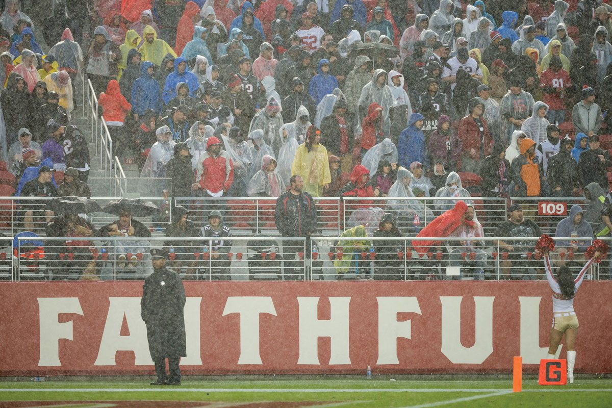 Fans endured the worst weather in years at Levi's Stadium on Sunday. It was a damper for what should've been a celebration for Eddie DeBartolo, who was recently inducted into the Pro Football Hall of Fame. (Stan Olszewski/Special to S.F. Examiner)