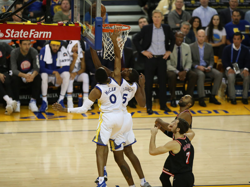 Kevon Looney (5) has looked like a totally different player for the Golden State Warriors this season. (Mira Laing/Special to S.F. Examiner)