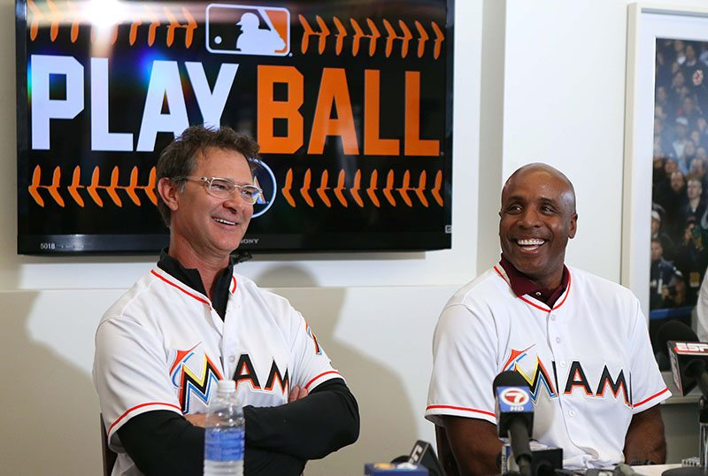 Miami Marlins manager Don Mattingly,left, and hitting coach Barry Bond speaking with the media during the team's FanFest at Marlins Park on Saturday. (David Santiago/El Nuevo Herald via AP)
