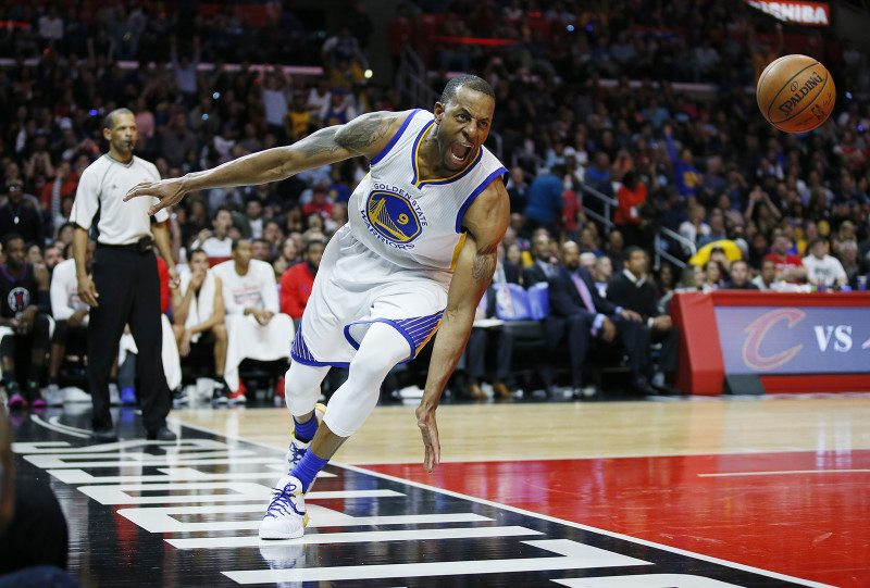 Andre Iguodala celebrates after scoring during the Warriors' 115-112 win over the Los Angeles Clippers on Saturday. (Danny Moloshok/AP)