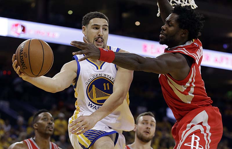 Klay Thompson (11) led in scoring against the Houston Rockets on Monday night in Stephen Curry's absence. The Warriors won, 115-106. (AP Photo/Ben Margot)