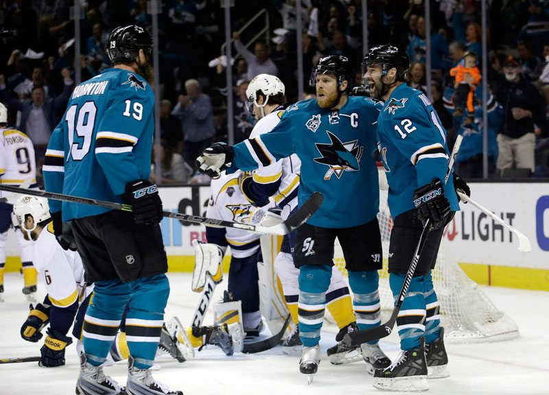 San Jose Sharks' Joe Pavelski, center, celebrates his goal with teammates Patrick Marleau, right, and Joe Thornton (19) during the first period of Game 7 in an NHL hockey Stanley Cup Western Conference semifinal series against the Nashville Predators on Thursday, May 12, 2016, in San Jose, Calif. (AP Photo/Marcio Jose Sanchez)