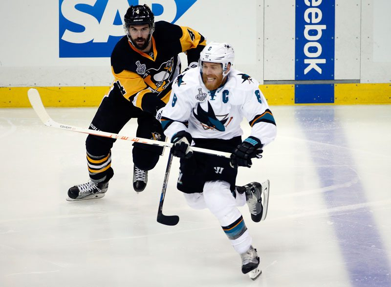 Joe Pavelski skates past Pittsburgh Penguins' Justin Schultz during the third period in Game 1 of the Stanley Cup finals on Monday. (Gene J. Puskar/AP)