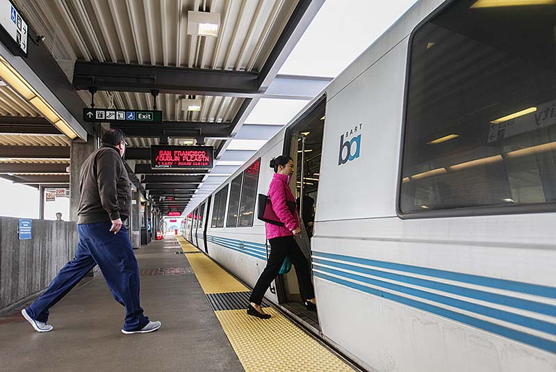 Passengers enter a BART train at the Daly City Station in San Francisco. (Ekevara Kitpowsong/Special to S.F. Examiner)