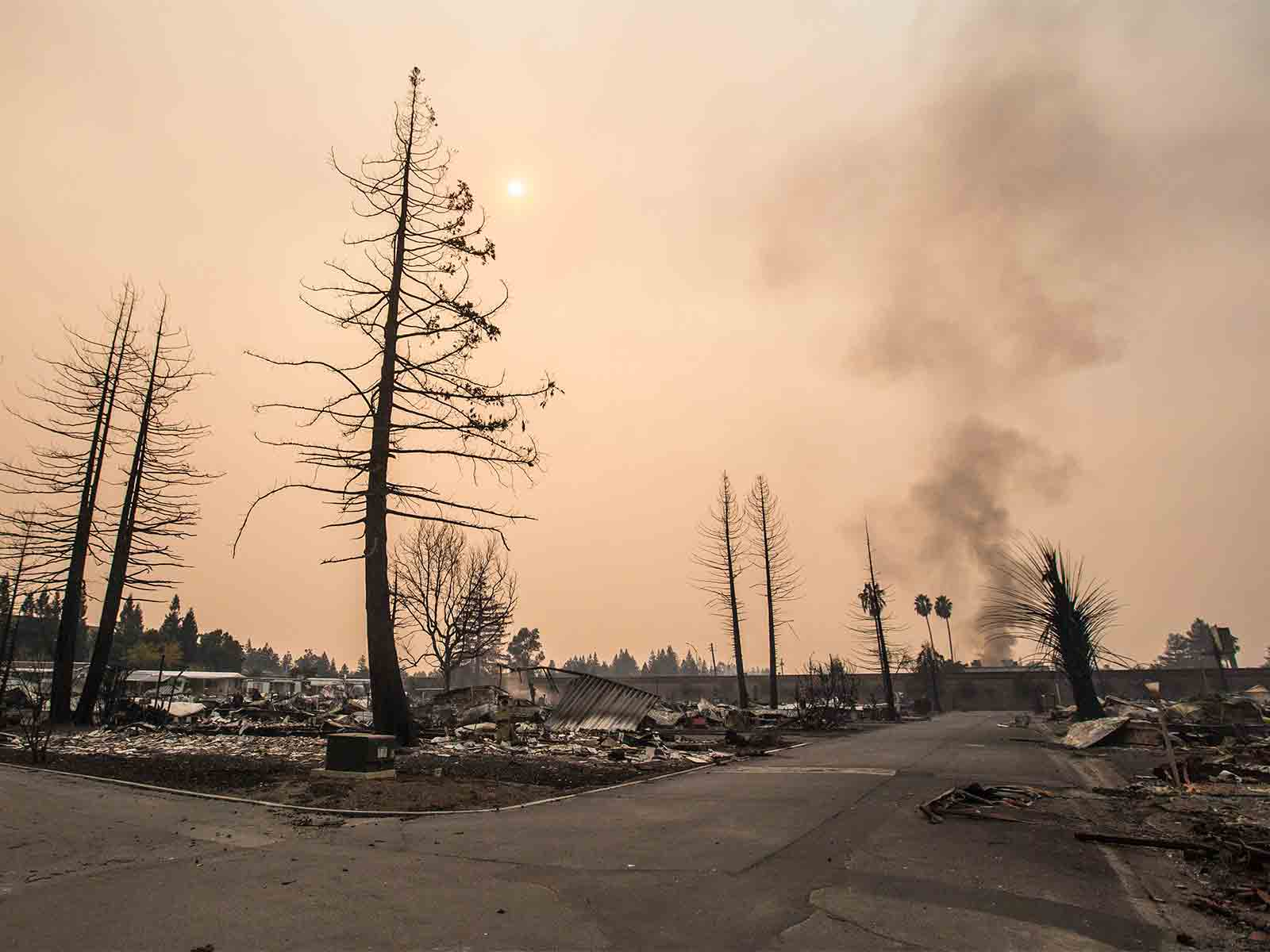Smoke rises over Journey's End mobile home park in Santa Rosa on Monday as multiple fires break out across Sonoma, Napa and other North Bay counties. (Jessica Christian/S.F. Examiner)