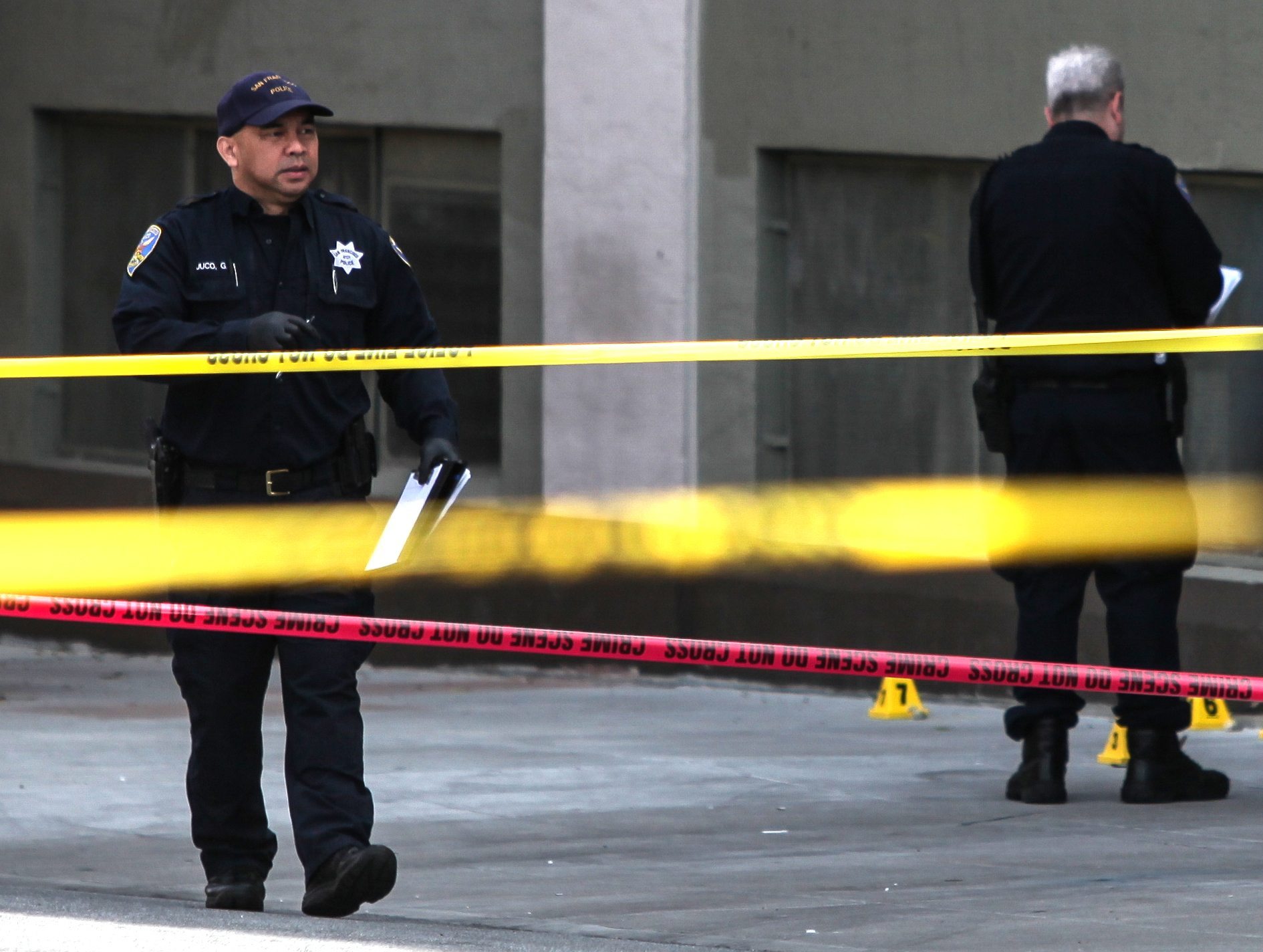 Crews investigate the scene after an officer involved shooting on Shotwell Street near 19th Street in San Francisco, Calif. Thursday, April 7, 2016. (Ekevara Kitpowsong/Special to S.F. Examiner)