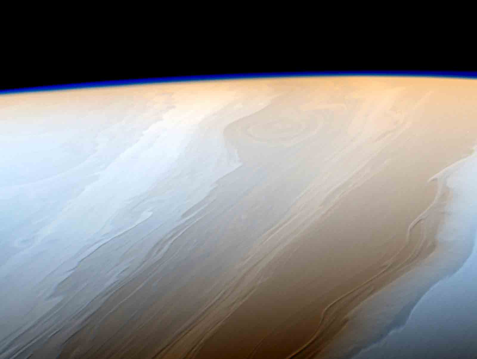 Clouds on Saturn take on the appearance of strokes from a cosmic brush thanks to the wavy way that fluids interact in Saturn's atmosphere. (Courtesy NASA)