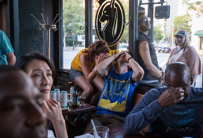 Warriors fans react to a missed shot as they watch the Golden State Warriors take on the Cleveland Cavaliers in game 7 of the NBA Finals during a viewing party at Luka's Taproom and Lounge in downtown Oakland. (Jessica Christian/S.F. Examiner)