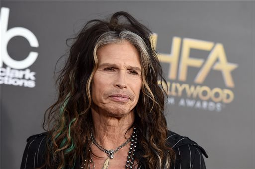 "Aerosmith frontman Steven Tyler, above, is asking Republican presidential candidate Donald Trump to stop using the power ballad ""Dream On"" at campaign events. (Photo by Jordan Strauss/Invision/AP, File)"