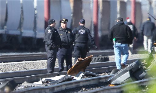Emergency personnel stand by debris from a deadly train crash in Chester, Pa., on Sunday. (Michael Bryant/The Philadelphia Inquirer via AP)
