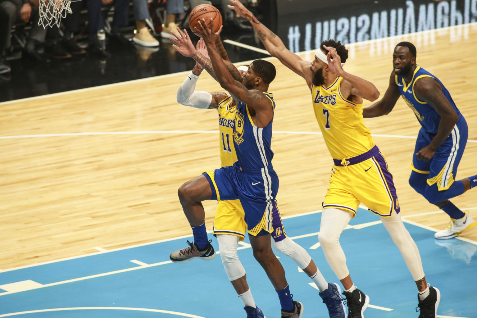 Alfonzo McKinnie (28) of the Golden State Warriors drives towards the basket  against JaVale McGee (7) and Michael Beasley (11) of the Los Angeles Lakers during the first quarter on October 12, 2018 at SAP Center in San Jose, California. (Chris Victorio / Special to S.F. Examiner)