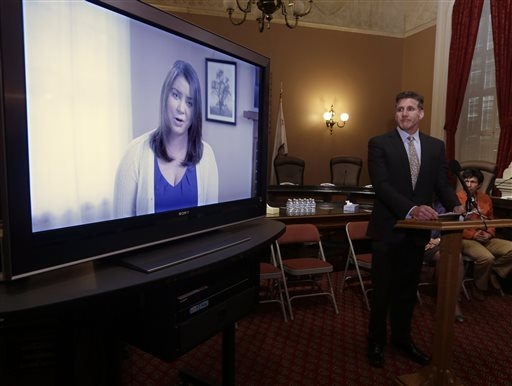 In this March 25, 2015 file photo, Dan Diaz, the husband of Brittany Maynard, watches a video of his wife, recorded 19 days before her assisted suicide death, where she says that no one should have to leave their home to legally end her life, during a news conference at the Capitol in Sacramento.  (AP Photo/Rich Pedroncelli, File)