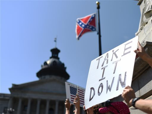 Protesters hold a sign during a rally to take down the Confederate flag at the South Carolina Statehouse on Tuesday. (AP Photo/Rainier Ehrhardt)