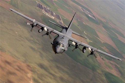 This photo provided by the U.S. Air Force shows an AC-130 Spectre from the 16th Special Operations Squadron flying a training mission at Cannon Air Force Base, N. M.  (U.S. Air Force photo/Master Sgt. Jack Braden via AP)