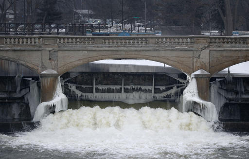 In this file photo, water from the Flint River flows through the Hamilton Dam near downtown Flint, Mich. (AP Photo/Paul Sancya, File)