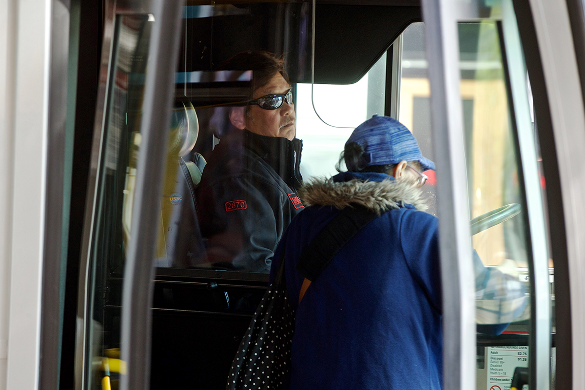A Muni driver waits as passengers board the 5R-Fulton Rapid bus at Market and Powell streets. (Kevin N. Hume/S.F. Examiner)