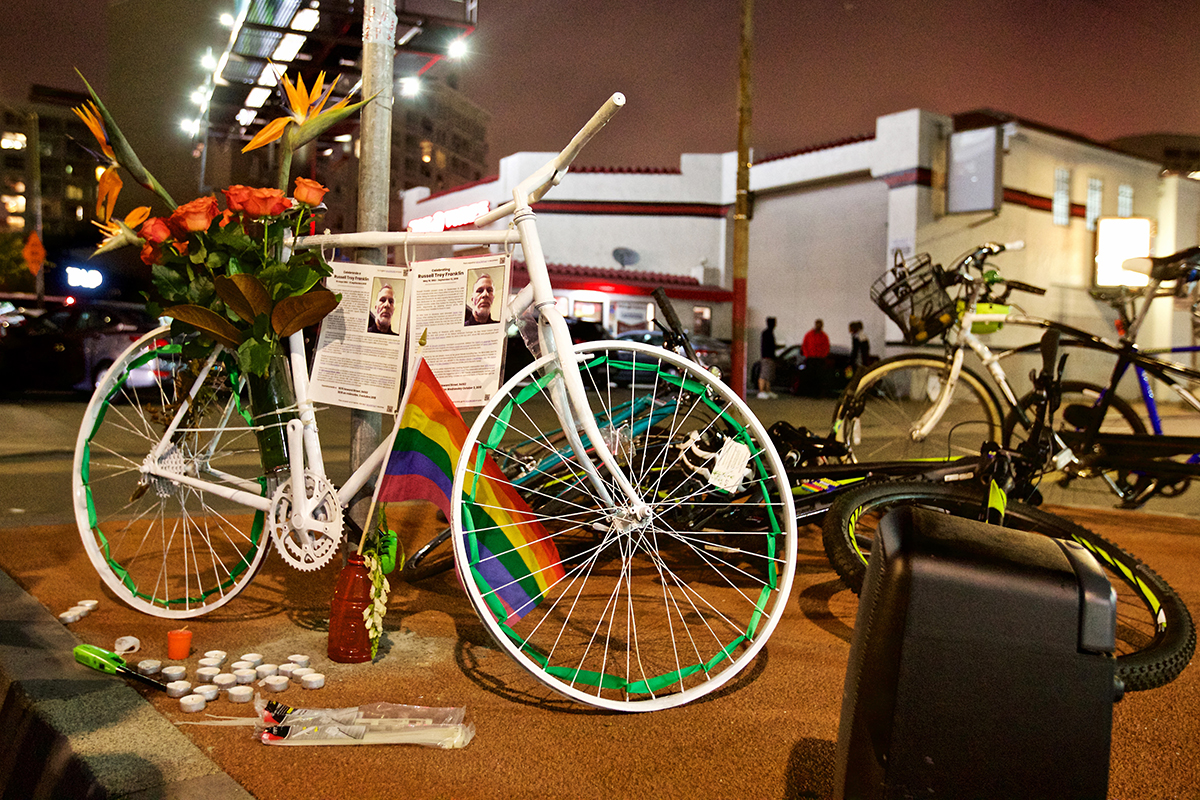 Flowers decorate a ghost bike at a memorial service for Russell Franklin on Wednesday, Oct. 3, 2018. Franklin was an avid cyclist who was struck and killed by a driver Sept. 13 near the intersection of Howard Street and South Van Ness Avenue. He was an activist who was an advocate for the LGBTQ community, for people living with or trying to prevent HIV/AIDS, people with disabilities and those trying to overcome homelessness and drug addiction. (Kevin N. Hume/S.F. Examiner)