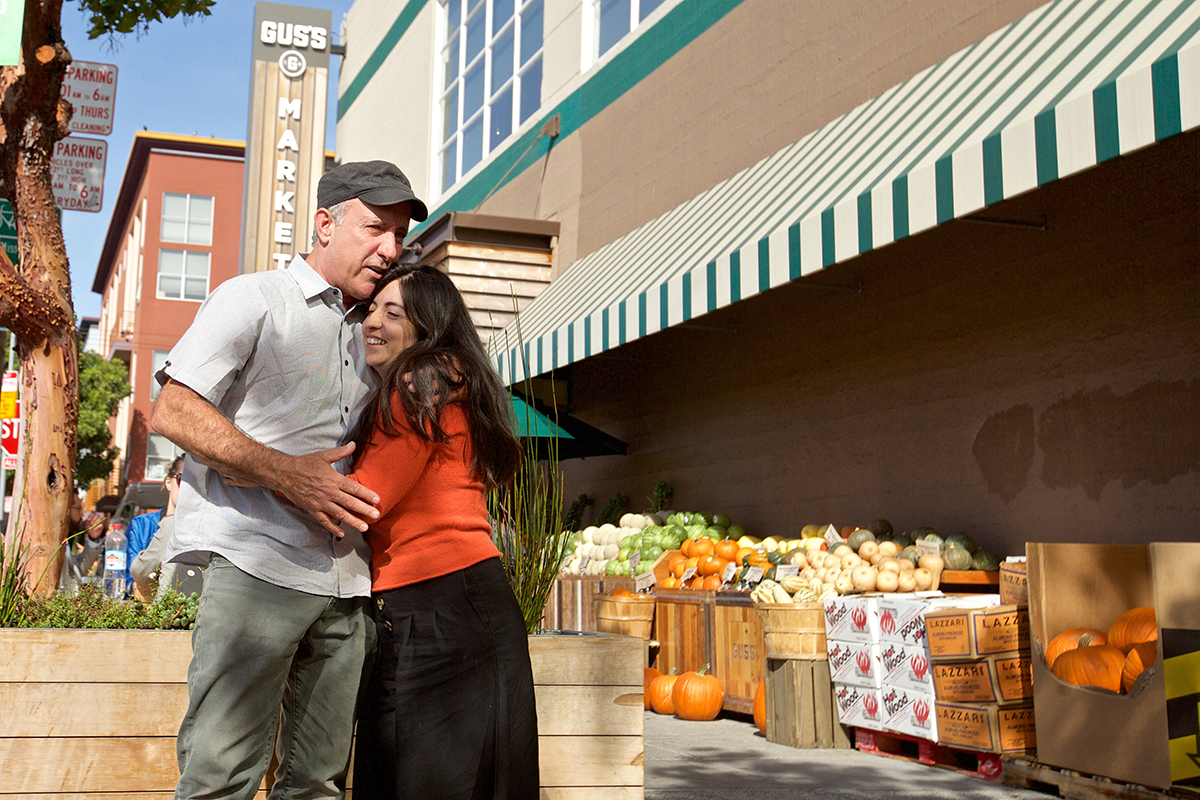 Dale Duncan and Marta Munoz outside Gus's Community Market  in the Mission District, the neighborhood they were forced out of.   (Kevin N. Hume/S.F. Examiner)