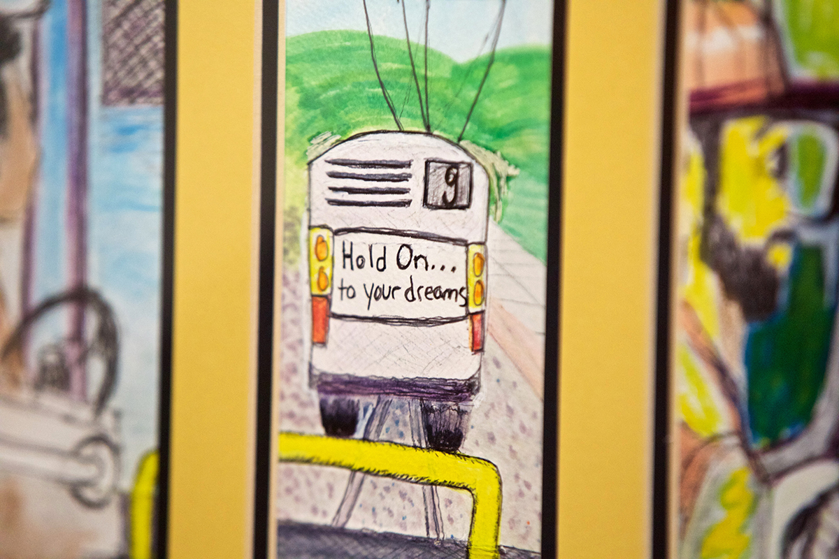 A painting of a 9 Muni bus by Kurt Schwartzmann, whose unique take on Muni drivers and Muni-centric artwork is being featured at the LightHouse for the Blind Gallery on Market Street, hangs in the gallery on Wednesday, Jan. 23, 2019. (Kevin N. Hume/S.F. Examiner)