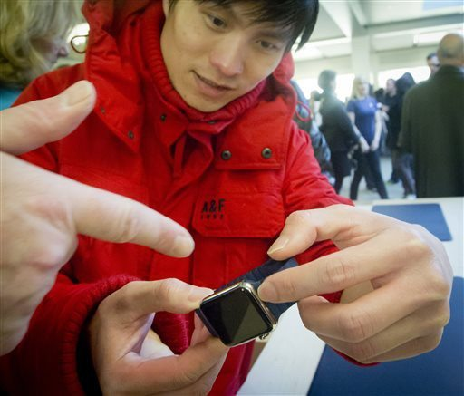 AP Photo/Bebeto MatthewsRicky Lea examines Apple's new watch