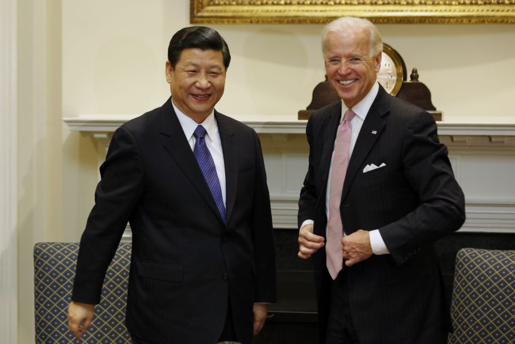 REUTERS/Larry DowningU.S. Vice President Joseph Biden and China's Vice President Xi Jinping  stand before an expanded bilateral meeting in the Roosevelt Room at the White House in Washington
