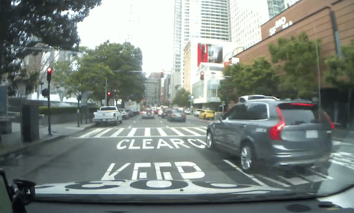 A screenshot from a video taken from the dashboard camera of a Luxor Cab that appears to show an Uber self-driving vehicle running a red light in the South of Market neighborhood on Wednesday. (Courtesy photo)