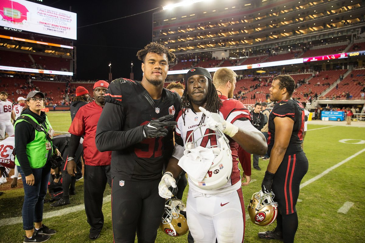 San Francisco 49ers defensive end Arik Armstead (91) and Arizona Cardinals outside linebacker Markus Golden (44) pose for a photo at Levi's Stadium in Santa Clara, Calif., on October 6, 2016. (Stan Olszewski/Special to S.F. Examiner)