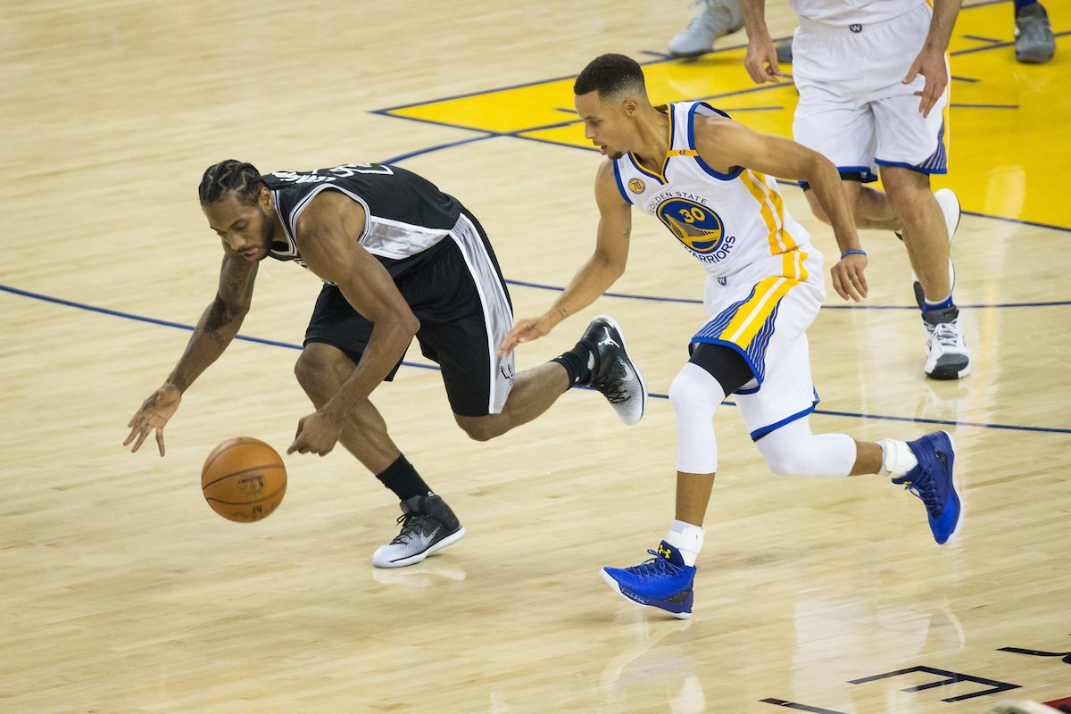Kawhi Leonard collects a Golden State Warriors turnover, a sight that was all too common Tuesday. (Stan Olszewski/Special to S.F. Examiner)