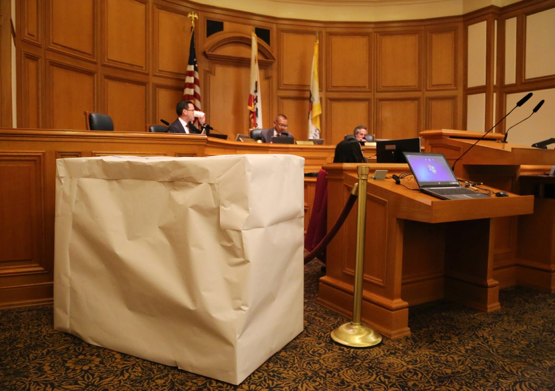 A mock delivery bot model is shown during a meeting at San Francisco City Hall discussing delivery robots Tuesday, October 3, 2017. A pedestrian safety committee opted not to endorse a proposed ban on delivery robots during the meeting. (Mira Laing/Special to S.F. Examiner)