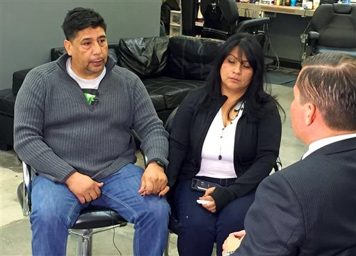 Beatriz Gonzalez, the mother of a 23-year-old Nohemi Gonzalez, a student killed in the Paris terrorist attacks, and stepfather Jose Hernandez speak to a reporter at Hernandez' barber shop in Norwalk. (AP Photo/Scott Fain)