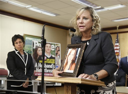 Debbie Ziegler holds a photo of her daughter, Brittany Maynard, the California woman with brain cancer who moved to Oregon to legally end her life last fall, during a news conference to announce the reintroduction of right to die legislation, Tuesday, Aug. 18, 2015, in Sacramento, Calif.  (Rich Pedroncelli/AP)