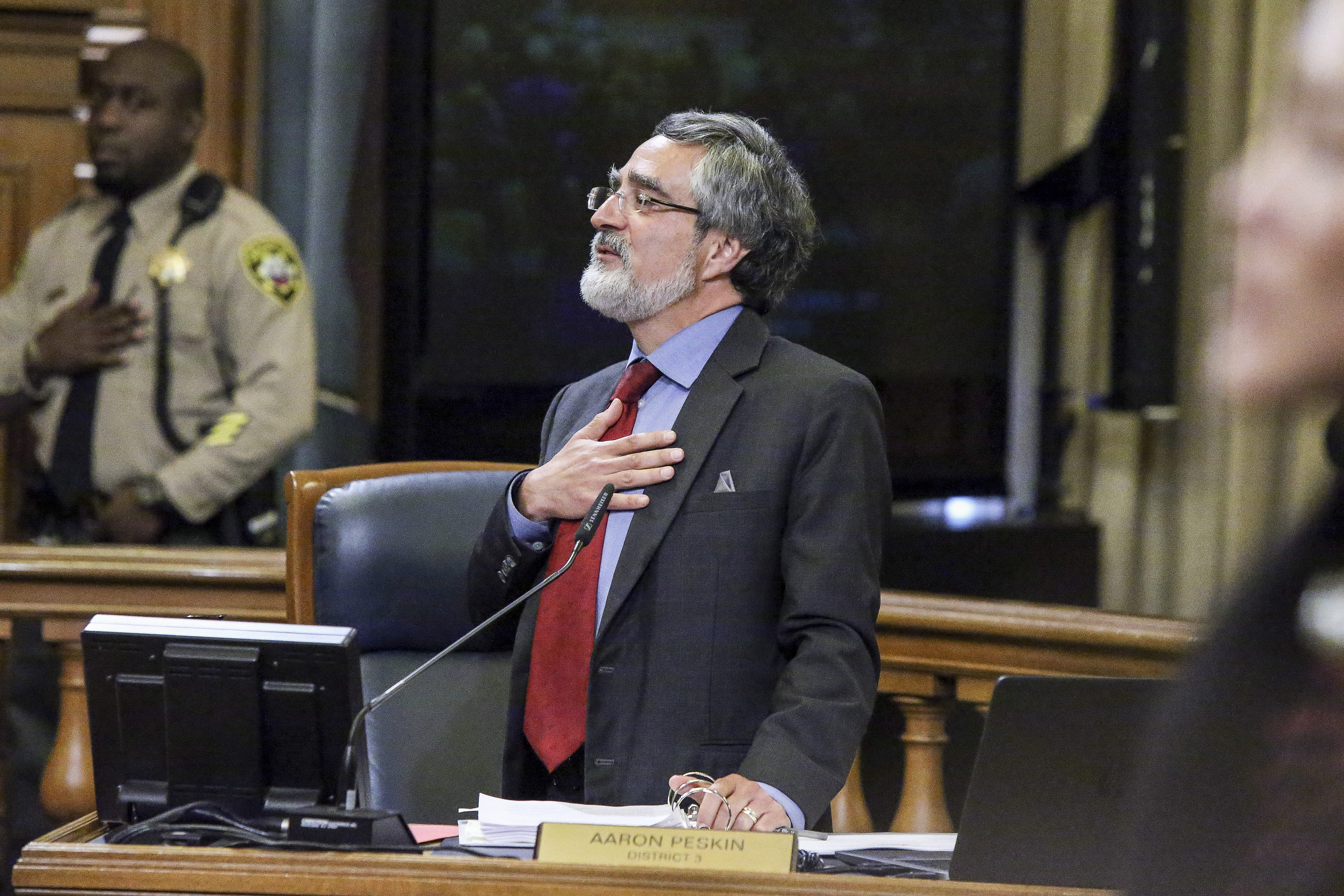 Supervisor Aaron Peskin takes his seat at the Board of Supervisors meeting shortly after bieng sworn in at a private ceremony in San Francisco's City Hall Tuesday, December 8, 2015. Supervisor Peskin won the District 3 seat from under the mayor appointed Julie Christensen in the November election which resulted in a 52 percent win over Christensen 43 percent. (Mike Koozmin/S.F. Examiner)