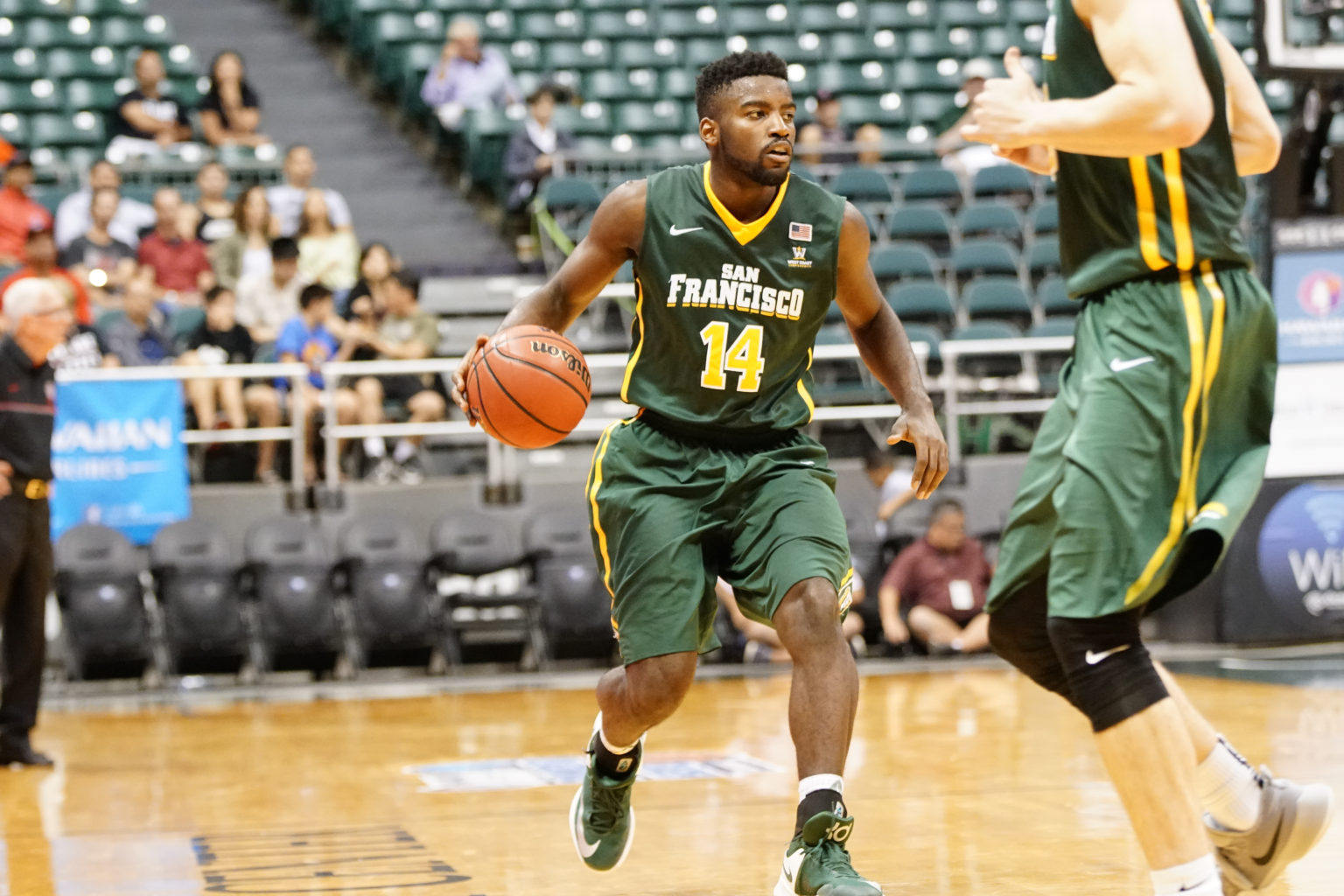 Charles Minlend dribbles the ball during the Stan Sheriff Center in Honolulu, Hawaii on Dec. 25, 2016, during the Championship Game of the Diamond Head Classic, USF MBB vs SDSU. (Courtesy / Chris M. Leung for USF Dons Athletics)