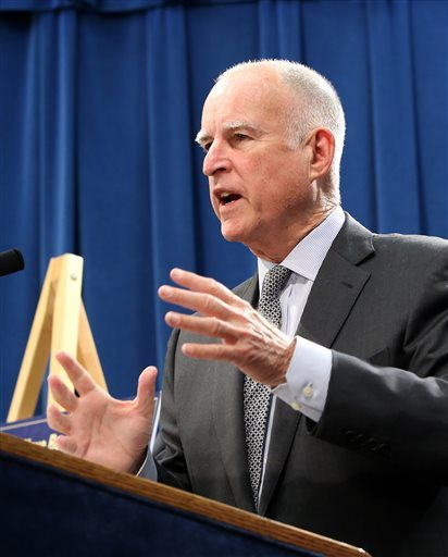 In this photo taken Thursday May 14, 2015, California Gov. Jerry Brown discusses his revised state budget plan during a news conference at the Capitol in Sacramento, Calif. As California lawmakers begin drilling into Brown's $115 billion budget proposal, Democrats and social welfare advocates say they see many areas that need even more funding to make up for deep cuts during the recession. (AP Photo/Rich Pedroncelli)